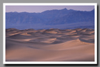 Sandy dunes resemble stormy seas in the Mesquite Flat Dunes  of Death Valley National Park in California.
