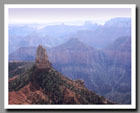 Light mists shroud the Grand Canyon from Point Imperial in Grand Canyon National Park in Arizona.