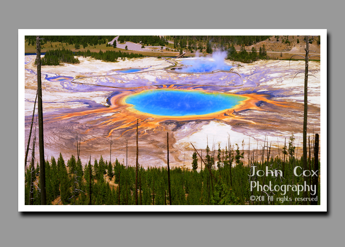 Steam rises above Grand Prismatic Spring in Yellowstone National Park in Wyoming.