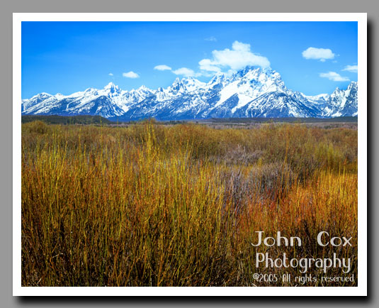An vast prarie leads to the base of the snow-capped Grand Tetons in Grand Teton National Park, Wyoming.