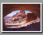 A sandstone landscape viewed through Tower Arch in Arches National Park, Utah.