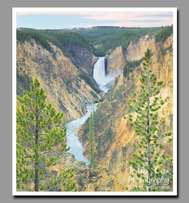 Yellowstone Falls fill the far reaches of the Grand Canyon of the Yellowstone with mist.
